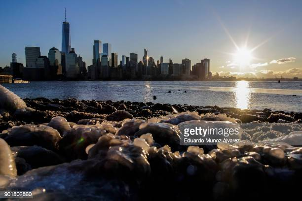 Ice floats along the Hudson River as the skyline of New York City and One world Trade Center are seen during freeze temperatures on January 06 2018...