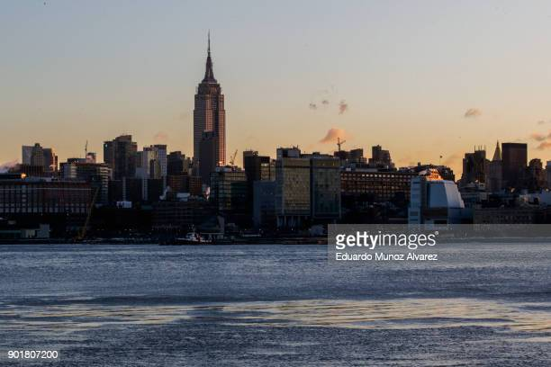 Ice floats along the Hudson River as the skyline of New York City and The Empire State Building are seen during freeze temperatures on January 06...