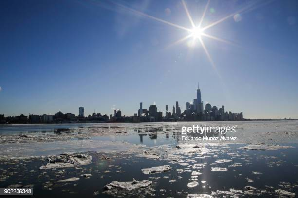 Ice floats along the Hudson River as the skyline of New York City and One World Trade Center are seen during freezing temperatures on January 07 2018...