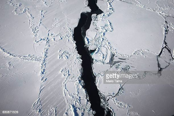 Ice floats near the coast of West Antarctica as viewed from a window of a NASA Operation IceBridge airplane on October 27 2016 inflight over...