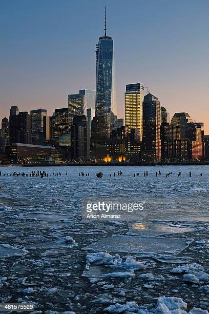 Ice floes fill the Hudson River as the Lower Manhattan skyline is seen during sunset on January 9 2014 in New York City A recent cold spell caused by...