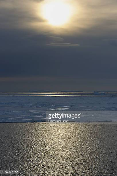 Ice floes with clouds and sun
