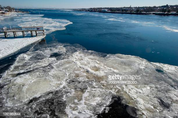 Ice flows fill the Merrimack River as it heads towards the Atlantic Ocean in Newburyport Massachusetts during the extreme cold temperatures caused by...