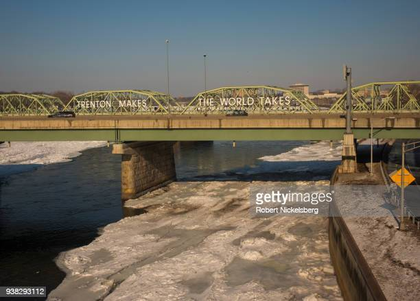 Ice flows on the Delaware River underneath the Lower Trenton Bridge January 9 2018 in Trenton New Jersey Numerous federal and state administrations...