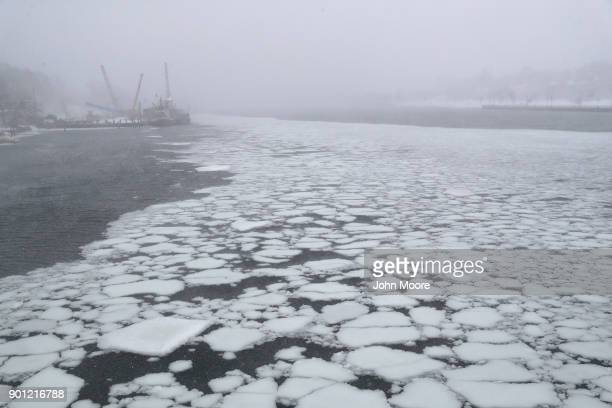 Ice flows through the New Haven Harbor on January 4 2018 in New Haven Connecticut The bomb cyclone was expected to dump heavy snows in New England as...