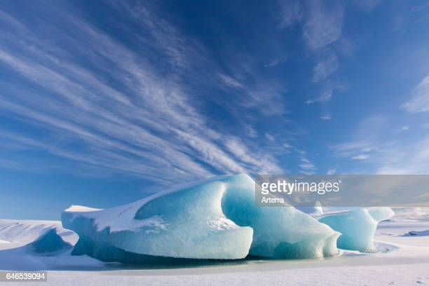 Ice formations in the Fjallsarlon Glacier Lagoon glacial lake in winter Iceland