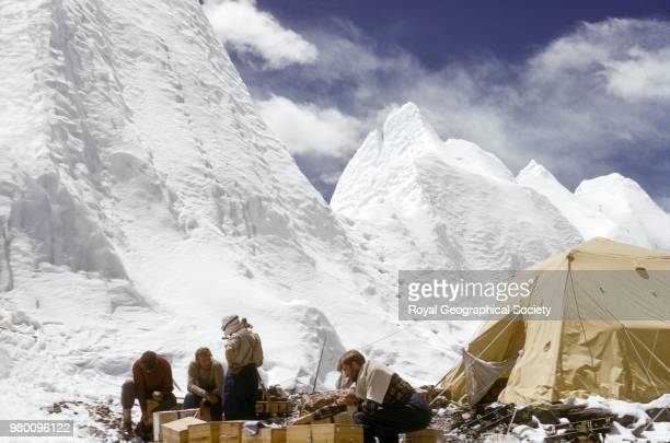Ice formations rising above Base Camp with Bourdillon Stobart Evans and Lowe in the foreground Nepal March 1953 Mount Everest Expedition 1953