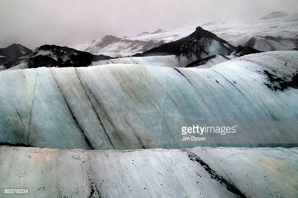 Ice forms in coloured strata on the Myrdalsjokull Glacier on February 20, 2009 in south Iceland. A country of glacial and volcanic geology, with a...