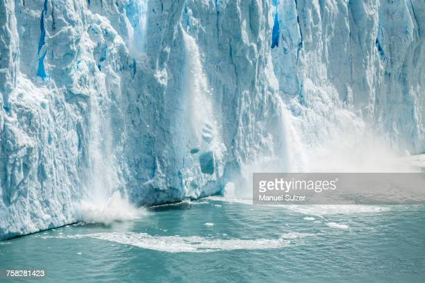 ice from perito moreno glacier falling into lake argentino, los glaciares national park, patagonia, chile - global warming stock pictures, royalty-free photos & images