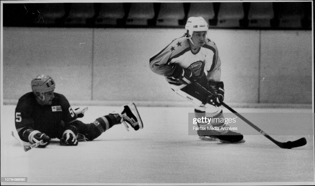 Ice Hocker: Sydney vs Adelaide at Macquarrie center Ice Rink SaturdayAugust 13.Jerry Ponton of Sydney carrying the puck past a fallen Allan Malste of Adelaide. : News Photo