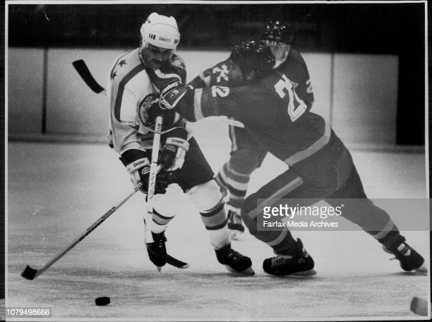 Sydney vs Adelaide at Macquarrie center Ice Rink Saturday August 13Jeff Taylor of Sydney is pushed off the puck by Peter Nixon of Adelaide Ice hockey...