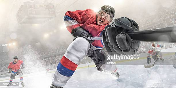 ice hockey action in extreme close up - ice hockey stock pictures, royalty-free photos & images