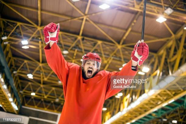 ice hockey celebrating - ice hockey uniform stock pictures, royalty-free photos & images