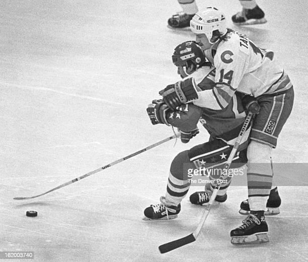 21982 FEB 13 1982 Ice Hockey Colorado Rockies Colo Rockies Steve Tambellini heads down the ice on the back of Washington's Dennis Maruk