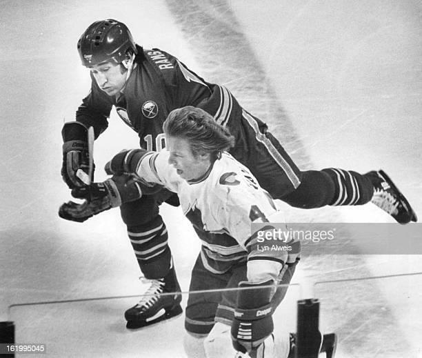Ice Hockey Colorado Rockies ; Colorado's John Van Boxmeer Buffalo's Crair Ramsay; One Way to keep the Enemy away from the Elusive Puck; Rockies' John...