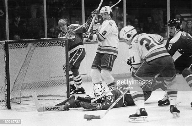 Ice Hockey Colorado Rockies ; In Background; Capitals 31-6 Gary Inness; 5 Rick Green; Rockies 9 Wilf Paiement; 21 Paul Gardner; Gardner Goal 1st...