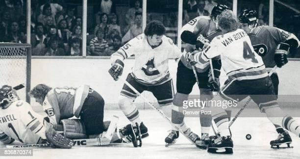 Ice Hockey Colorado Rockies is Rockies' player rep Bounding puck causes traffic jam in front of Rockies' Goal While Philadelphia's Bobby Clarke tries...