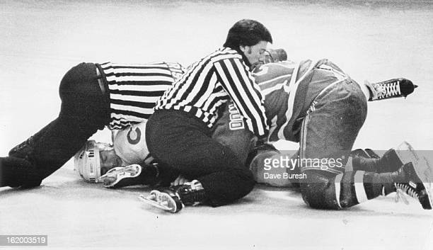 DEC 12 1980 DEC 13 1980 Ice Hockey Colorado Rockies Officials Won't Let Boys be Boys Officials Jim Christison left and Joe Dame try to pry Colorado's...