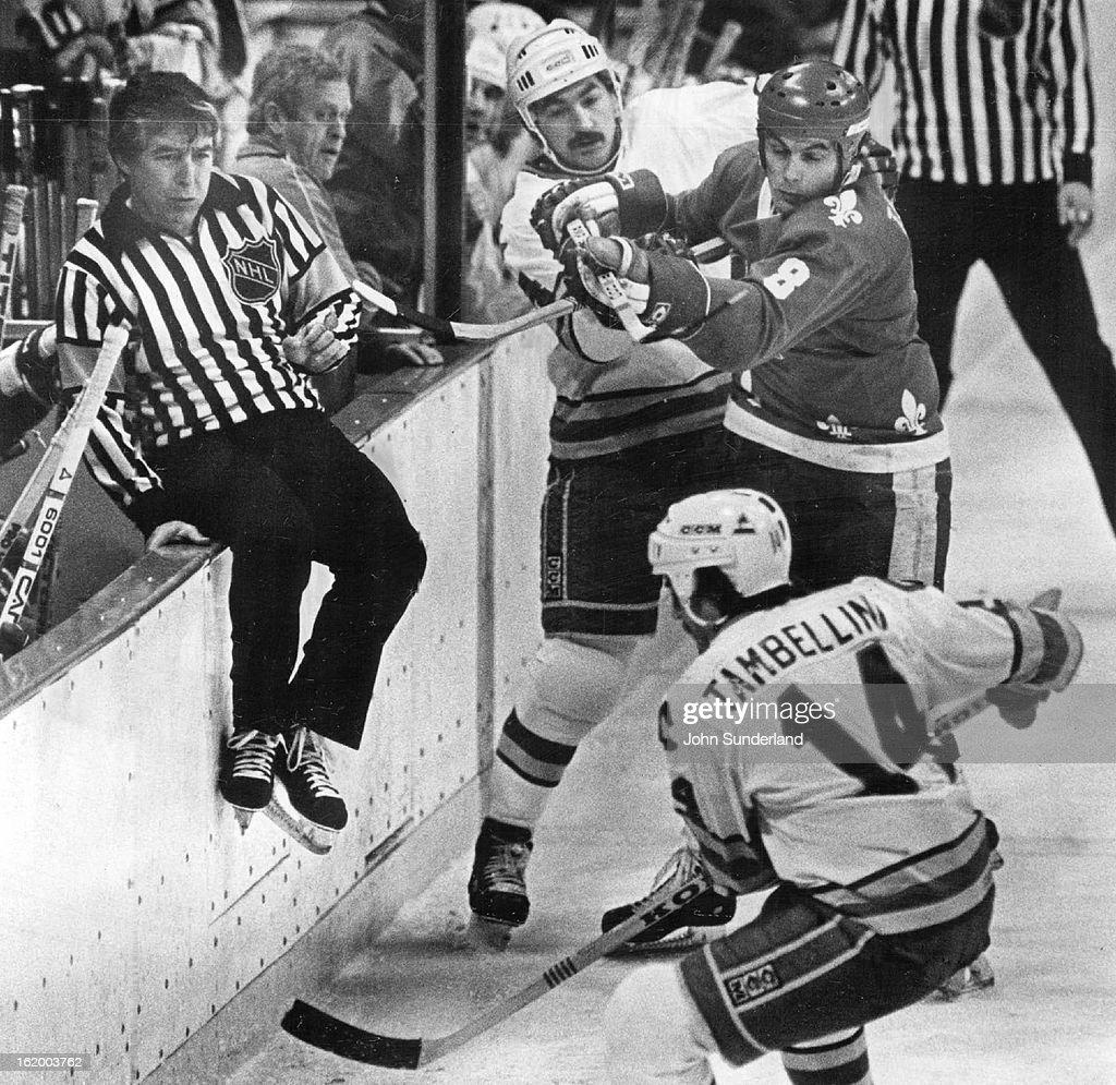 FEB 12 1982, FEB 14 1982; Ice Hockey - Colorado Rockies (Action); Referee Ron Wicks avoids scramble  : News Photo