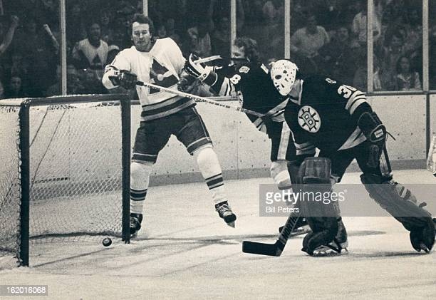 JAN 3 1981 JAN 4 1981 Ice Hockey Colorado Rockies Rockies Shooter Out of Picture but Puck's in Net Boston's Jim Craig and Dick Redmond watch with...