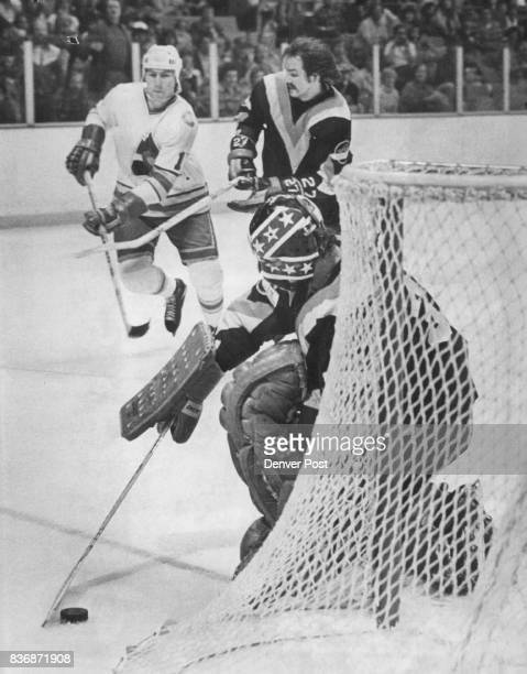 Ice Hockey Colorado Rockies Vancouver Goaltender Dunc Wilson Harold Snepsts Jack Valiquette left of Colorado glides by under the check of Vancouver...