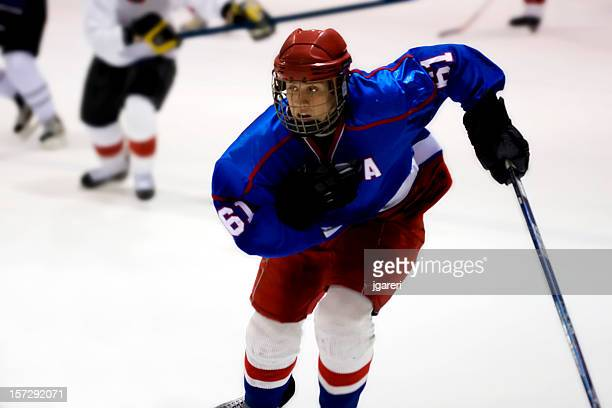 ice hockey game action shot - ice hockey uniform stock pictures, royalty-free photos & images