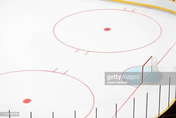 Ice hockey goal and empty rink.