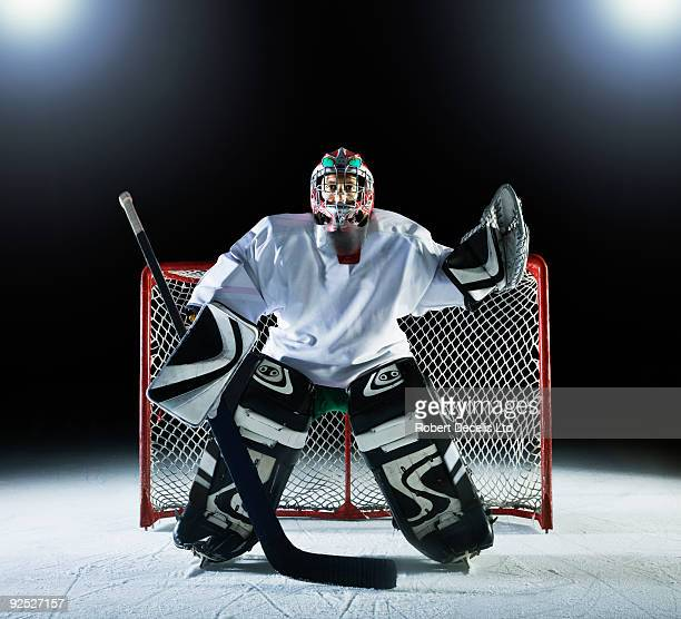 ice hockey goal keeper in front of goal - ice hockey rink stock pictures, royalty-free photos & images