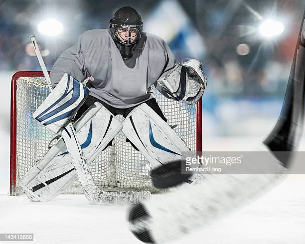 Ice hockey goal keeper protecting goal