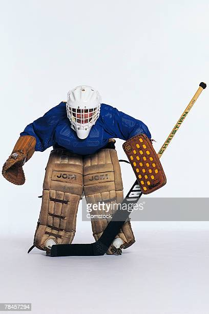ice hockey goalie in stance - goalkeeper stock pictures, royalty-free photos & images