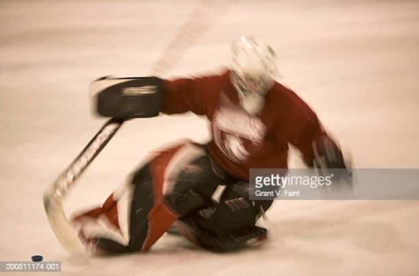 ice hockey goalie making save (blurred motion) - ice hockey glove stock pictures, royalty-free photos & images