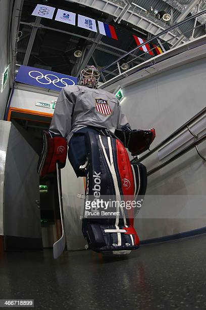 Ice hockey goalkeeper Brianne McLaughlin enters the rink for a practice session ahead of the Sochi 2014 Winter Olympics at Shayba Arena on February 3...