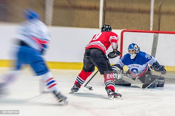 Ice hockey goalkeeper defending goal