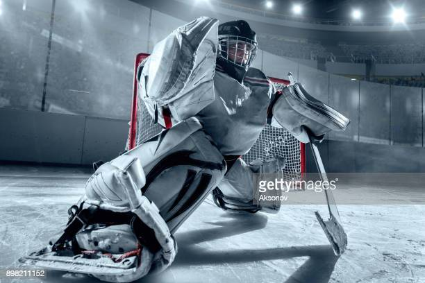 ice hockey goalkeeper protects the goal - face off sports play stock photos and pictures