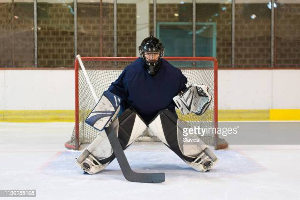ice hockey goaltender defending his goal - goalkeeper stock pictures, royalty-free photos & images