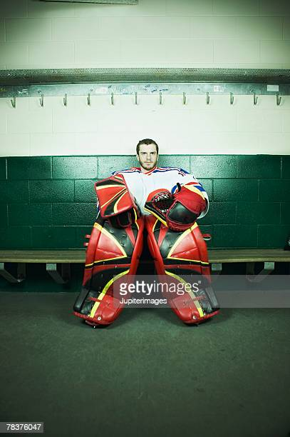 ice hockey goaltender sitting on bench - goalkeeper stock pictures, royalty-free photos & images