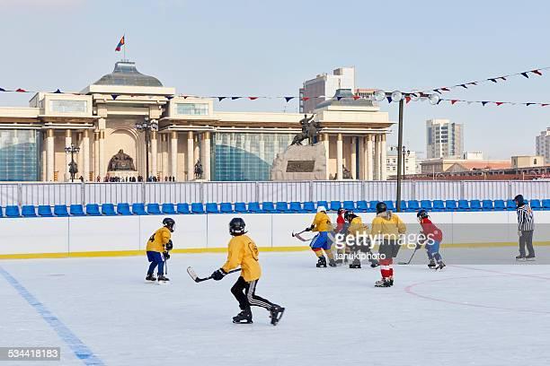 ice hockey in ulaanbaatar - ice hockey uniform stock pictures, royalty-free photos & images