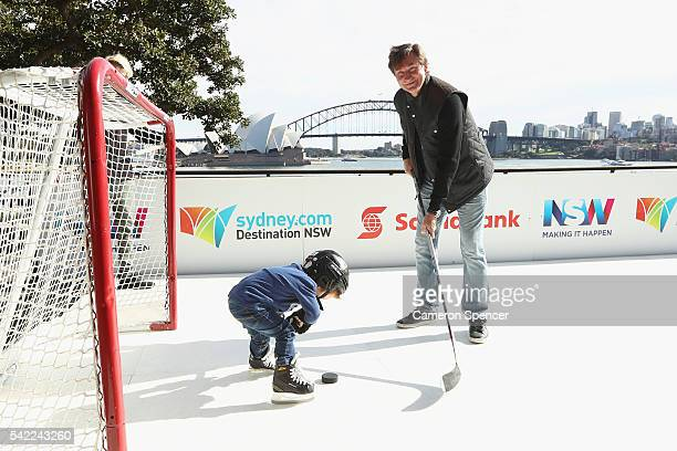 Ice Hockey legend Wayne Gretzky passes a puck with a young ice hockey player at Lady Macquarie's Chair on June 22 2016 in Sydney Australia Wayne...