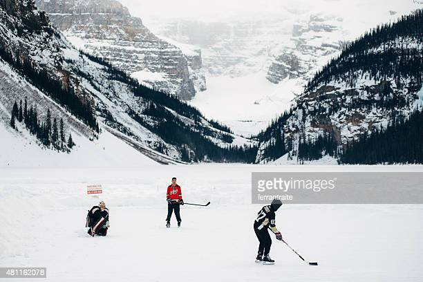 ice hockey over lake louise in banff national park canada - calgary alberta stock pictures, royalty-free photos & images