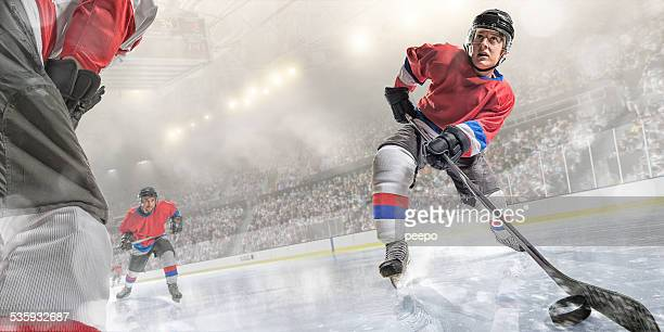 ice hockey player action - face off sports play stock photos and pictures