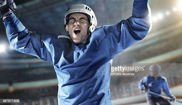 Ice hockey player celebrate inside hockey arena