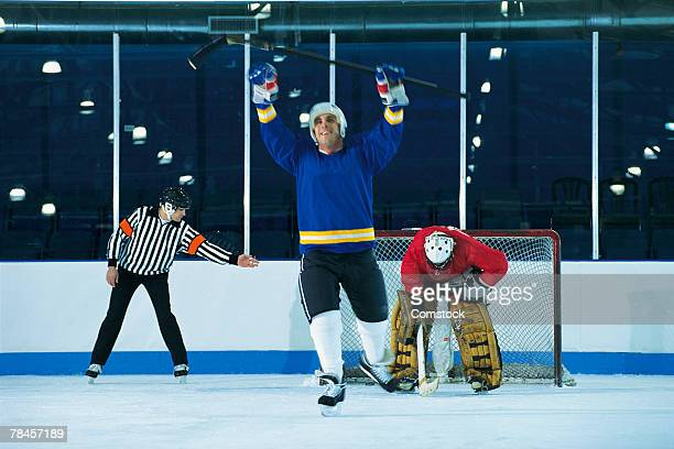 ice hockey player celebrating goal - hockey player stock pictures, royalty-free photos & images