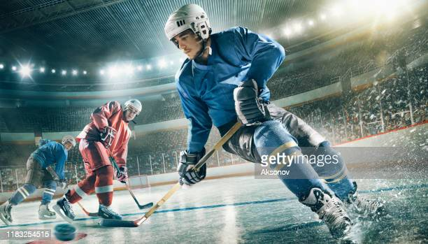 ice hockey player in action - hockey player stock pictures, royalty-free photos & images