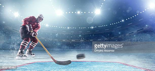 ice hockey player in action - ice hockey stock pictures, royalty-free photos & images