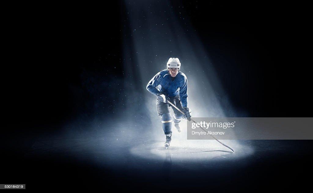 Ice hockey player is spotlight : Stock Photo