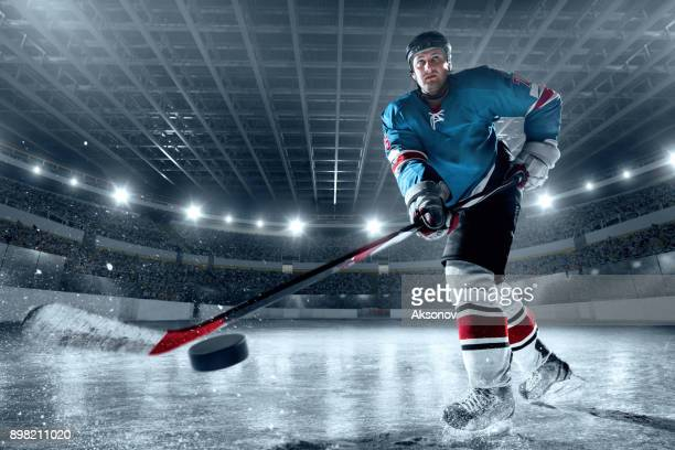 ice hockey player on big professional ice arena - hockey player stock pictures, royalty-free photos & images