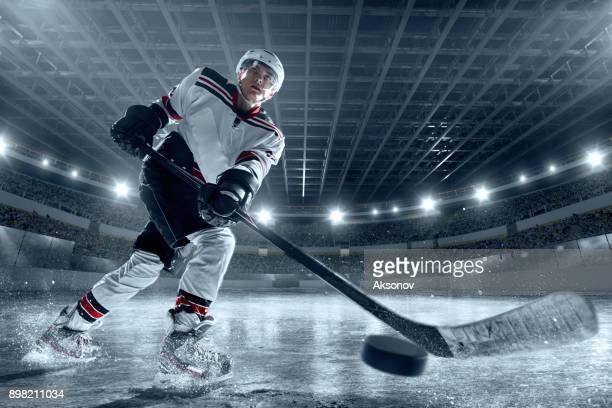 ice hockey player on big professional ice arena - face off sports play stock photos and pictures