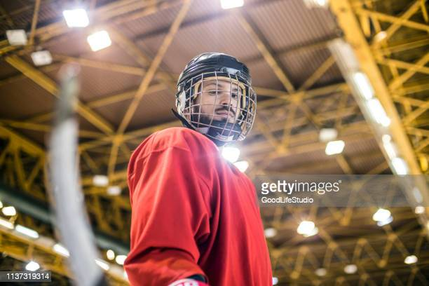 ice hockey player - ice hockey uniform stock pictures, royalty-free photos & images