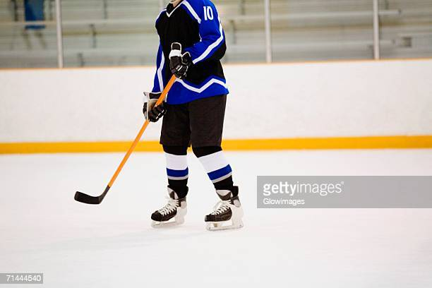 ice hockey player playing ice hockey - ice hockey glove stock pictures, royalty-free photos & images