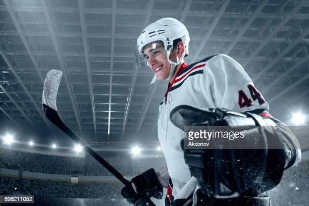 ice hockey player rejoices in victory - hockey player stock pictures, royalty-free photos & images